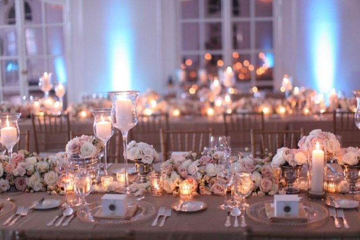 Vintage wedding table decor with silver vases