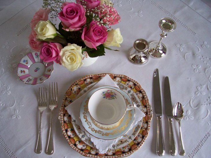 Vintage wedding table decoration with China teacups and saucers