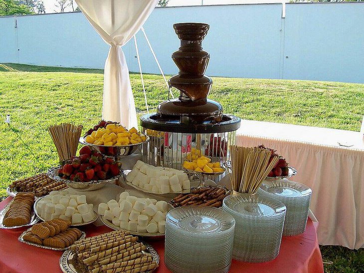 Wedding dessert table decor with chocolate fondue station and savories