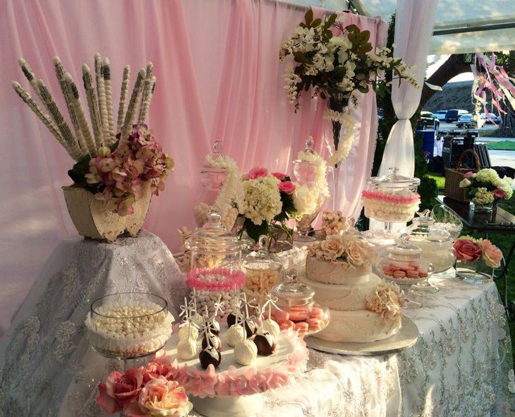 Wedding dessert table decor with roses and hydrangeas