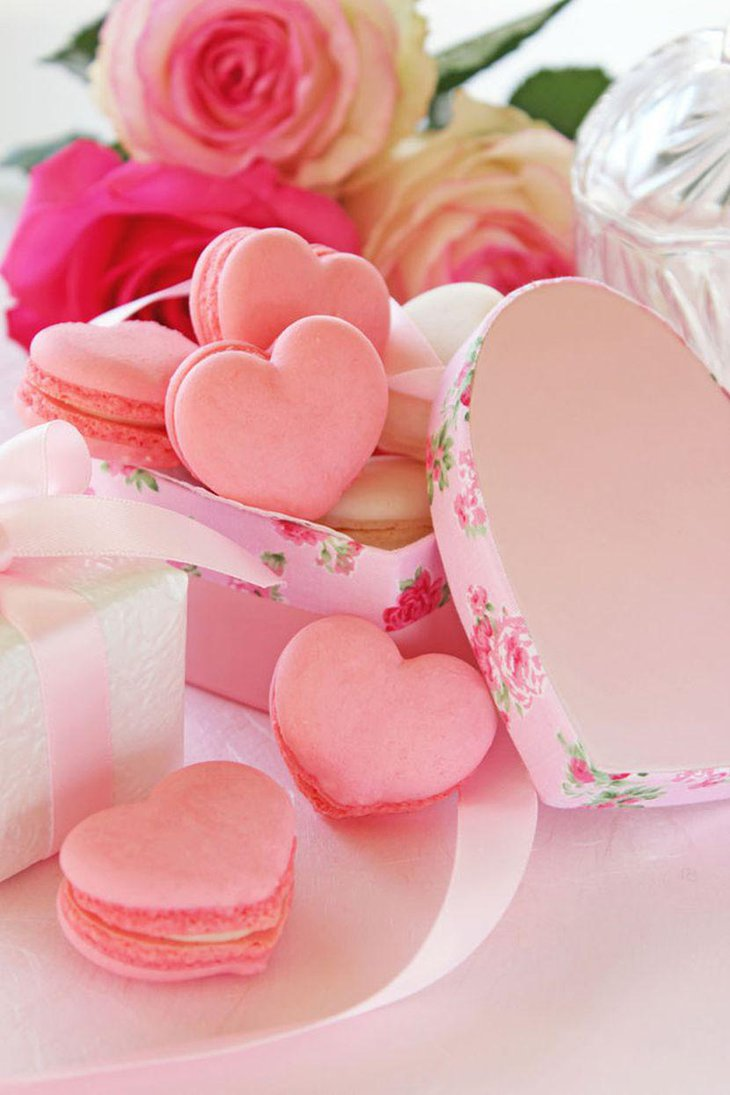 Wedding dessert table decorations with pink heart shaped cookies in a box