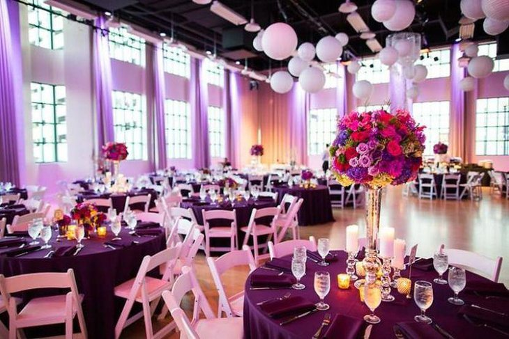 Wedding Table Decor With Dark Purple Cloth And Flowers