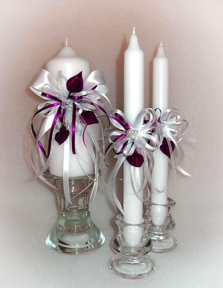 Wedding table decor with handmade white and deep purple unity candles