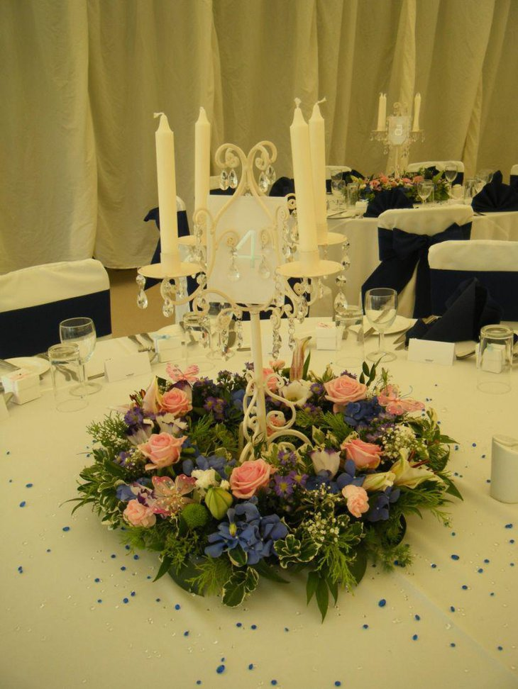 Wedding table decor with vintage candelabra and flowers