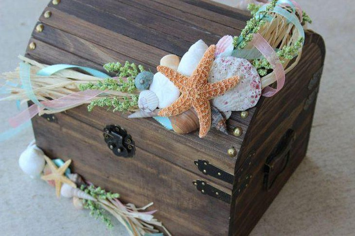 Wedding treasure chest card holder centerpiece with shells and starfish embellishments