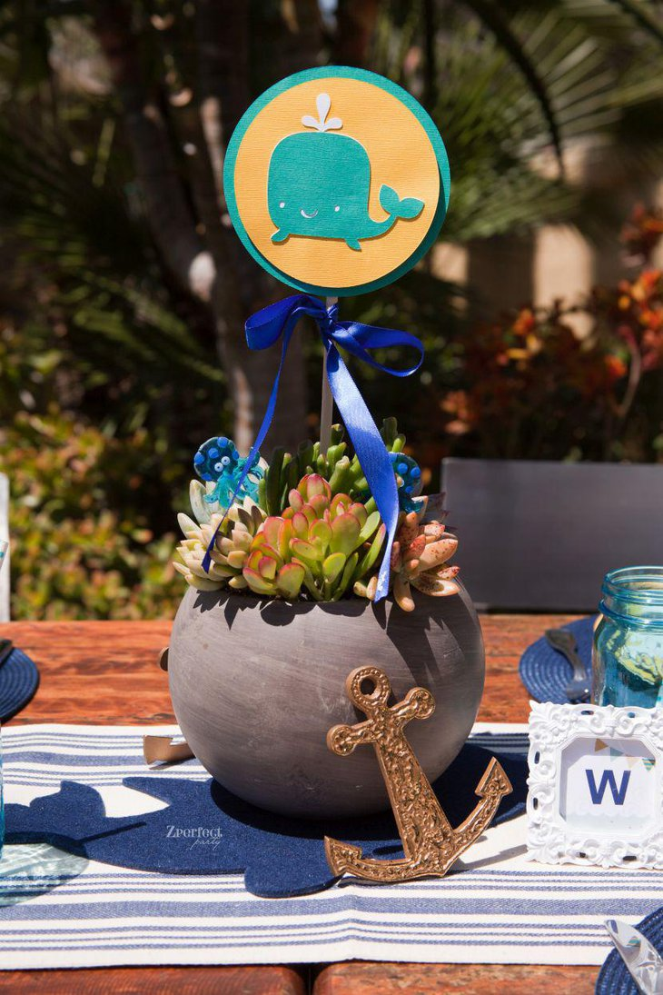 Whale and anchor baby shower table setting with nautical theme