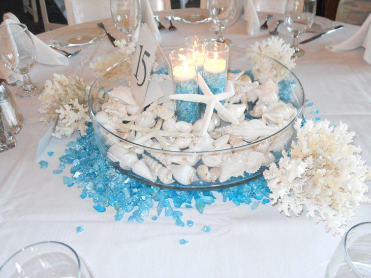 White and blue beach themed candle wedding centerpiece