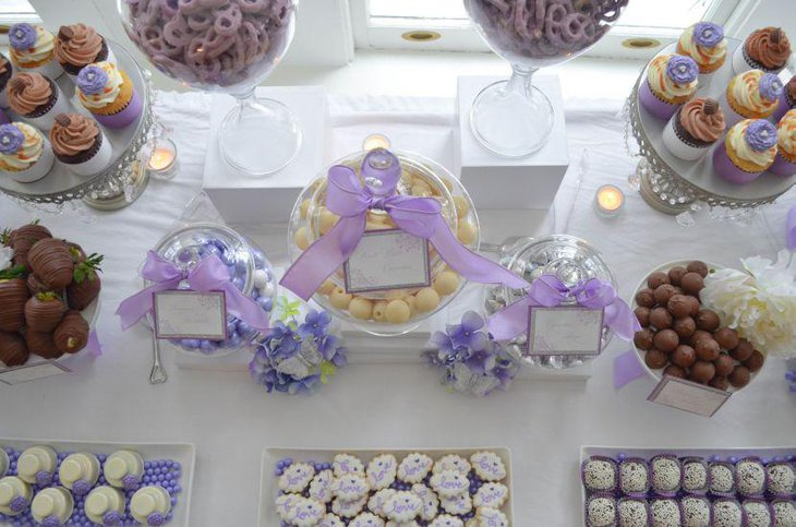 White and purple candy display on baby shower candy table