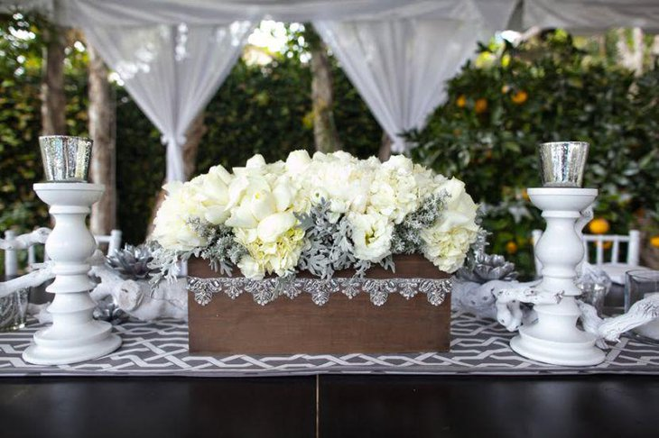 White and silver candle holders and roses for party table decor