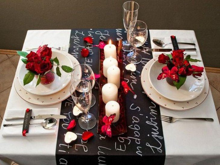 White candles and plates decor on Valentines table