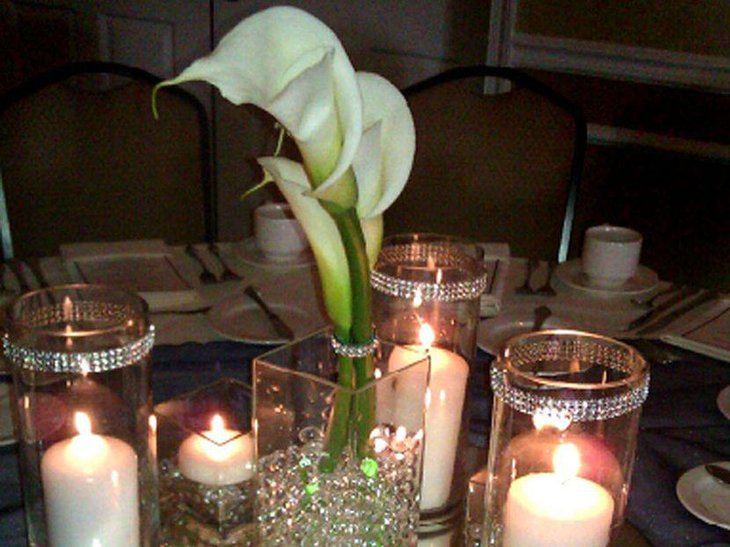 White candles in bling holder centerpieces for wedding tables
