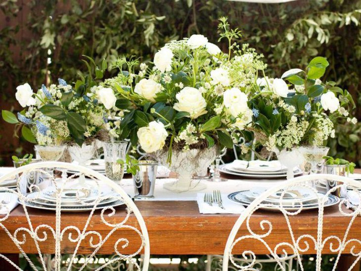 White floral decor on an outdoor bridal shower table