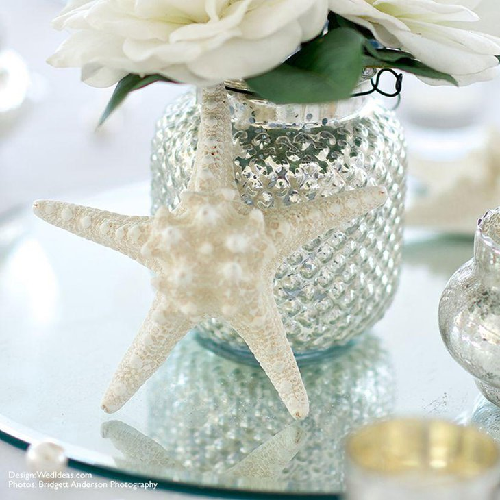 White starfish wedding table centerpiece with flowers