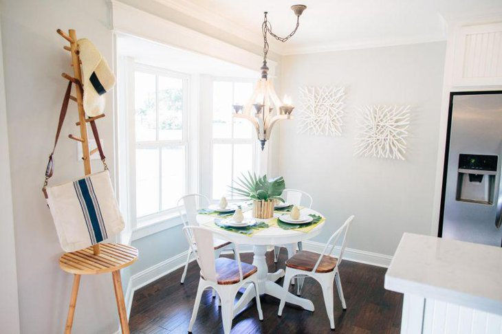 White themed breakfast nook with loads of natural lighting