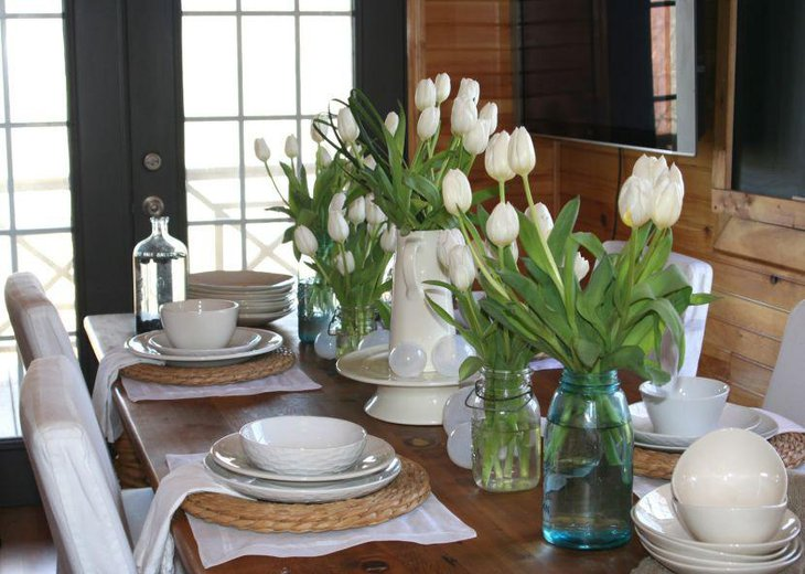 White Vase And Transparent Bottles With Flowers As Dining Table Centerpiece  Ideas