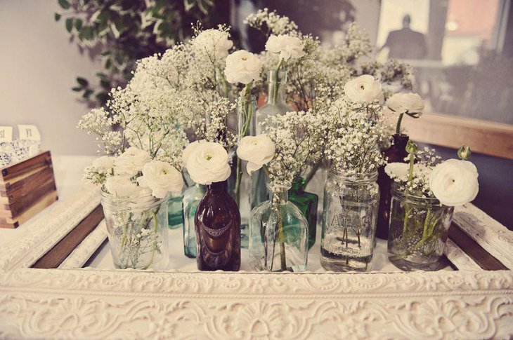 White vintage wedding table decor with flowers