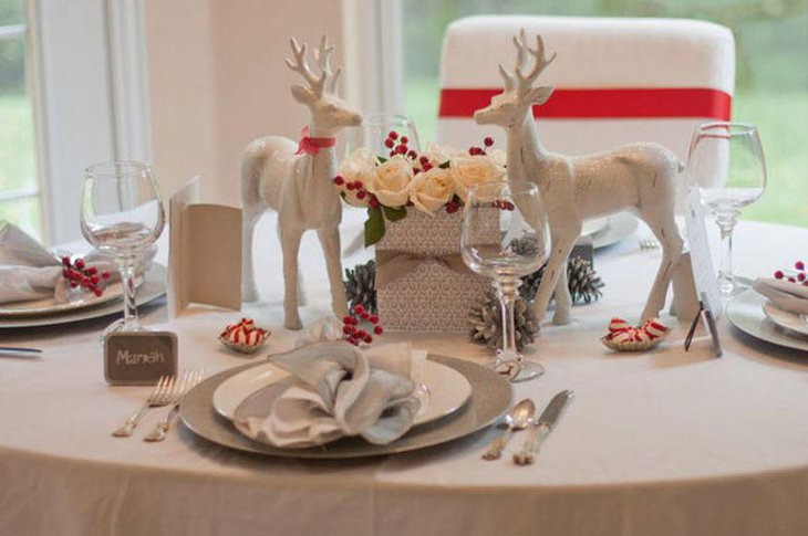 Winter table decor with red berries and pines