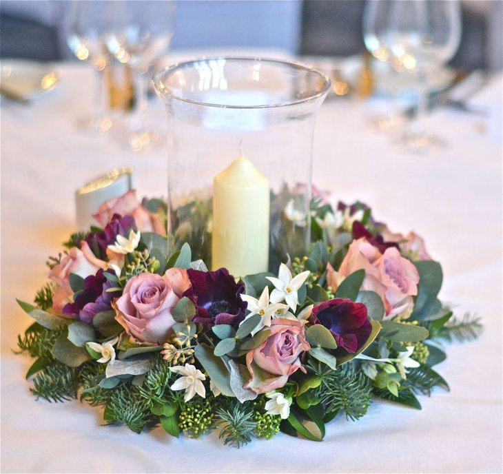 Winter table decor with wintery foliage and candle jar