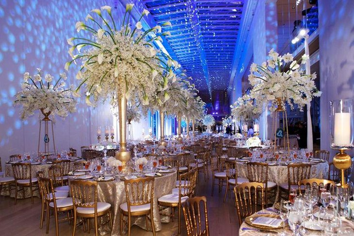 Winter wedding table decor with tall golden floral vases