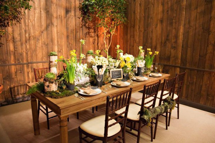 Wonderful spring Italian table decorated with greens