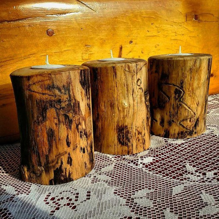 Wooden candle holder centerpieces on a country wedding table