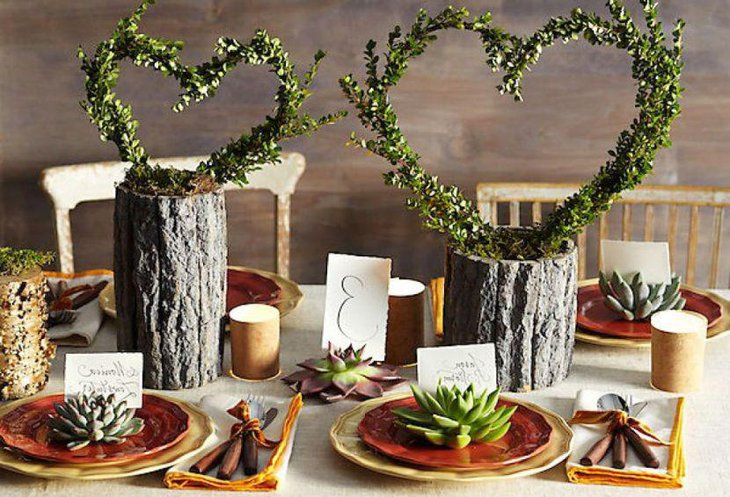 Wooden log heart centerpieces on a country wedding table