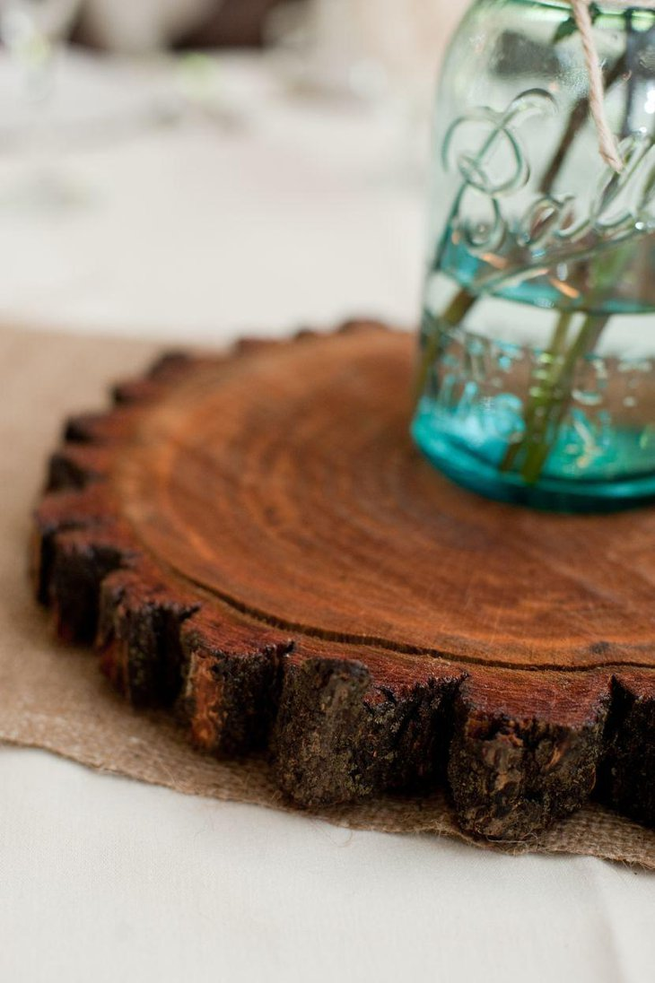 Wooden slice centerpiece on a country wedding table