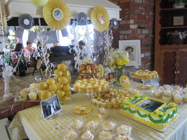 Yellow accented 80th birthday dessert table decor for a grandma