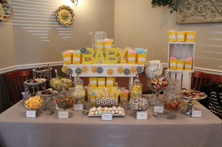 Yellow and silver candy display on baby shower candy table