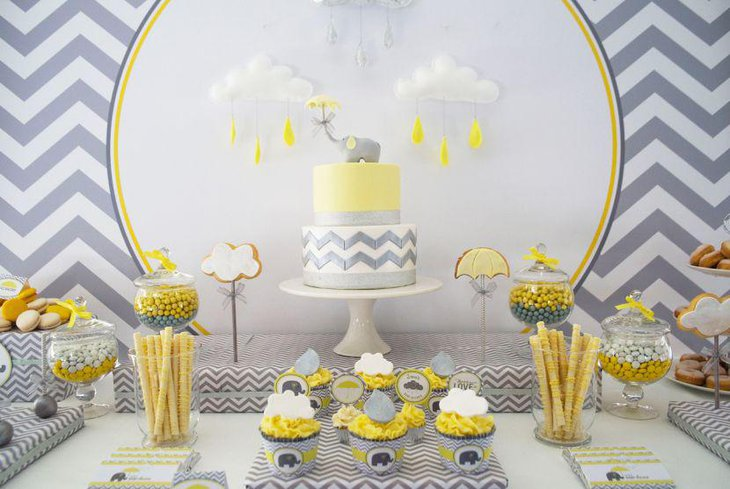 Yellow candies display on elephant themed baby shower candy table