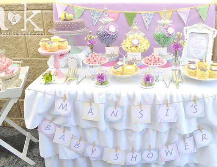 Yellow purple and green candy display on baby shower candy table