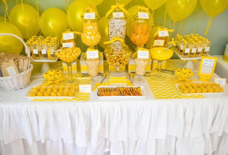 Yellow themed buffet spread for baby shower