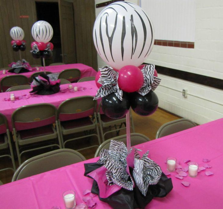Zebra printed balloon centerpiece on Valentines party table